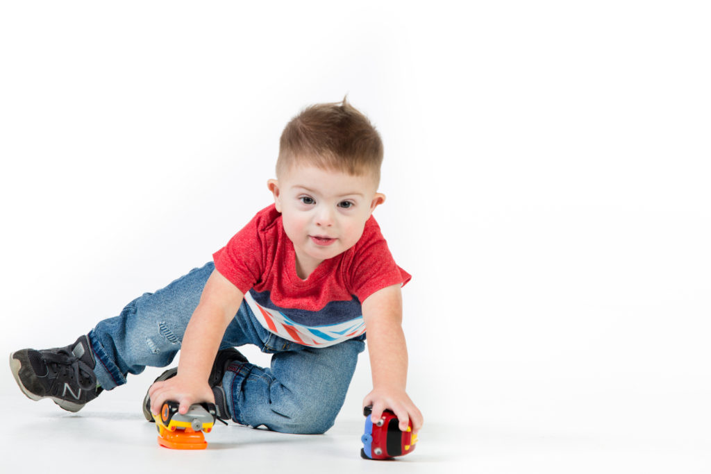 Toddler boy with toy trucks