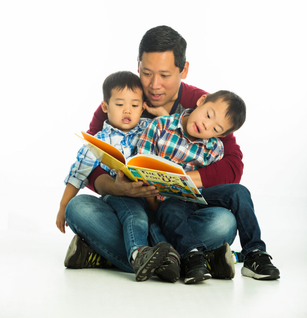 Dad with two boys, reading